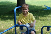 Picture of a child on outdoor playground equipment